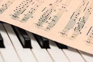 sheet music and piano