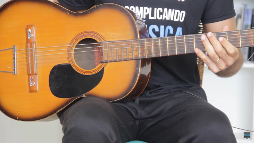 guitar on the right leg